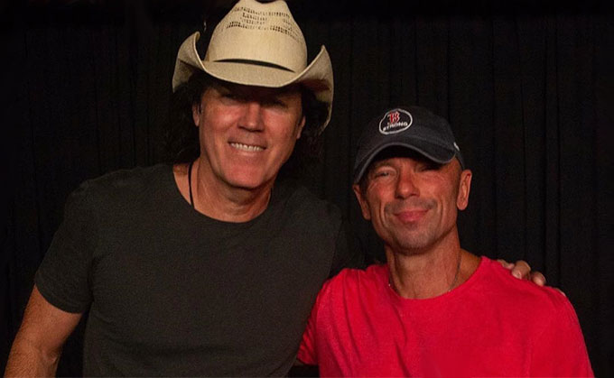Kenny Chesney and David Lee Murphy.
